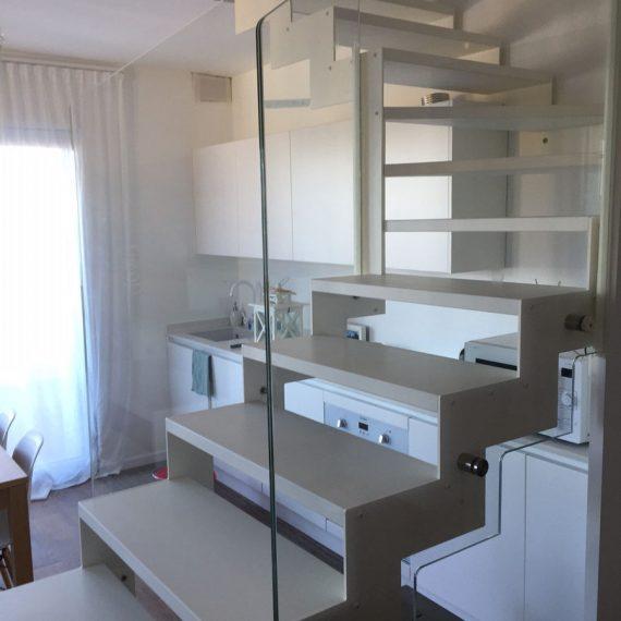 Realizzazione e progettazione zona cucina, living e scala per casa privata Celle Ligure